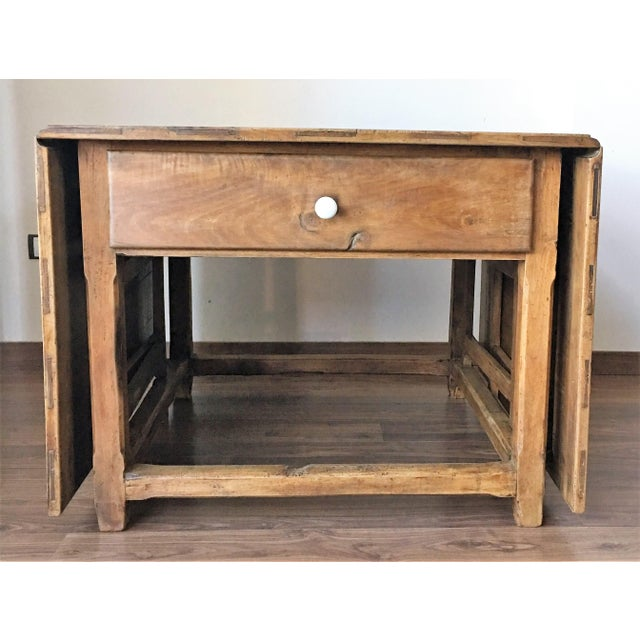 Drop-leaf table with gate-legs. This 18th century, Spanish rustic farmhouse style table features two drop leaves, gate...