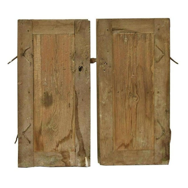 A rustic and primitive pair of solid mesquite and pine antique windows from Mexico. Handcrafted in the 19th century,...