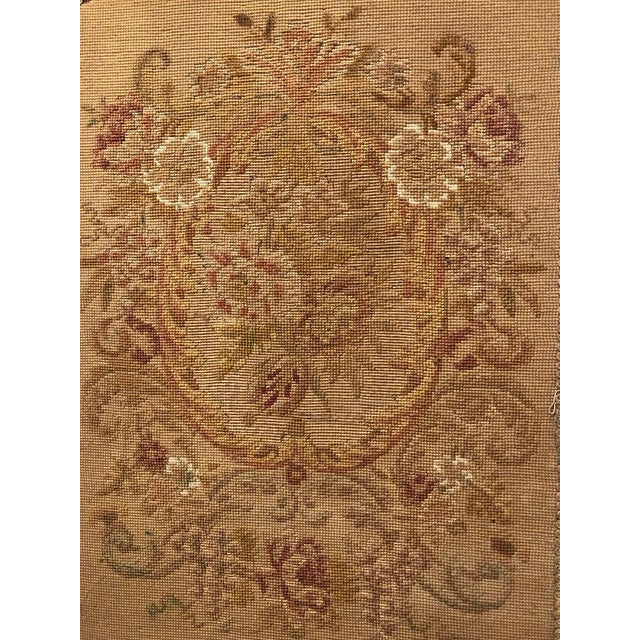 This stunning French Louis XVI carved oak fireplace screen is ca. 1900. It has an arched floral crest over a floral...