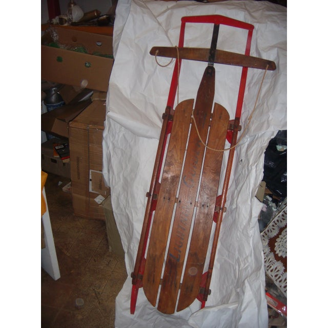 Offered is a very nice old Lightning Glider sled of wood and iron. Great color. Wonderful decor accessory.