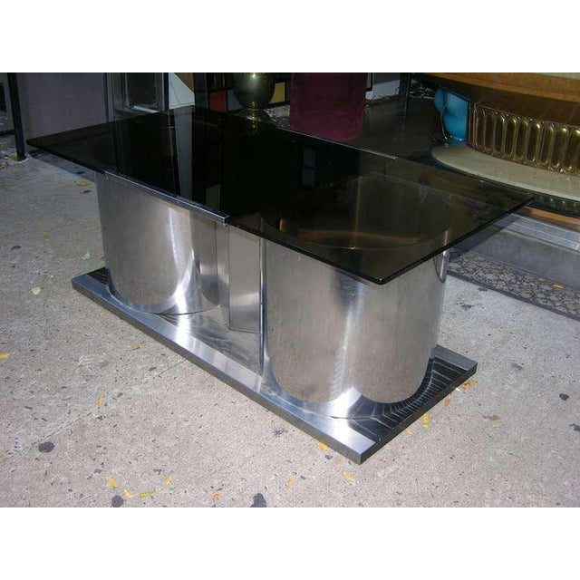 An elegant coffee table / bar with a high quality tempered smoked glass top that swivels to reveal a lacquered interior...