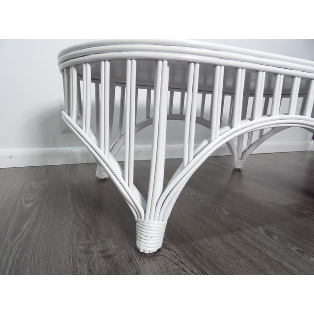 Vintage bamboo & woven rattan coffee table in new striking crisp white lacquer finish. The top is tightly woven rattan and...