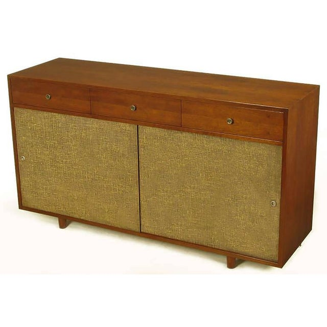 Beautifully restored to original condition, nine drawer dresser or cabinet, with sliding linen wrapped doors. Three...
