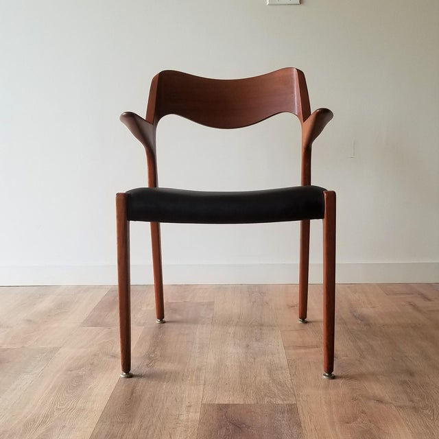 Newly upholstered, in black leather, 1960s Model 55 Chair by Niels Moller for his company J.L Mollers Mobelfabrik. The...