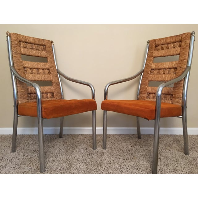 Very unique set of four dining chairs by Chromcraft. Fantastic design with sweeping thick chrome arms and legs offset by...