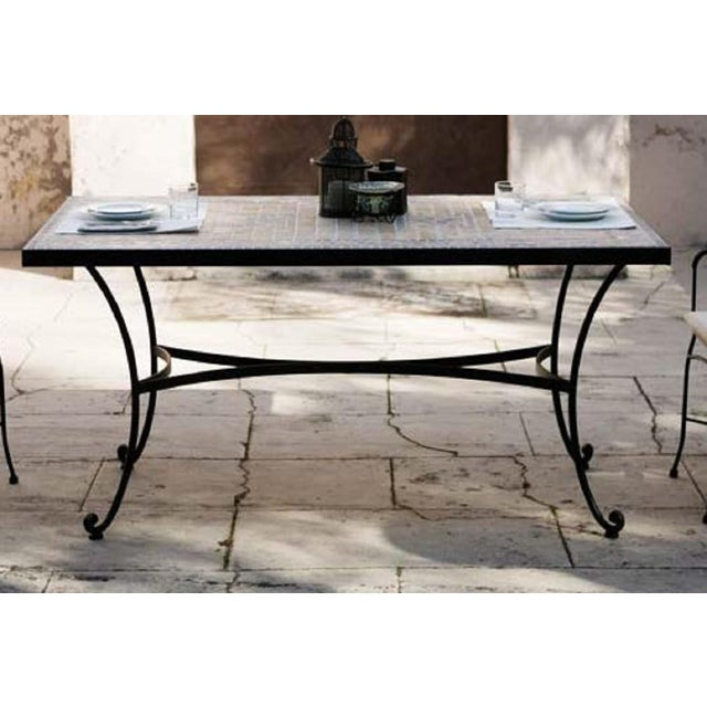 About Patio or garden dining room table in wrought iron with glass top Estructure measurements: Depth 27.5 in Width 47.24...