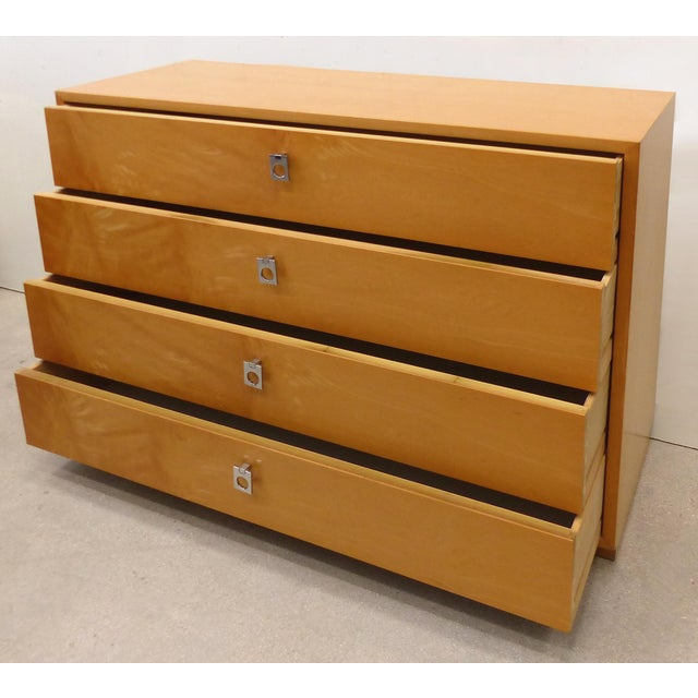 Available for sale is a slender mid-century Modern dresser designed by Jack Cartwright for Founders Furniture Company....