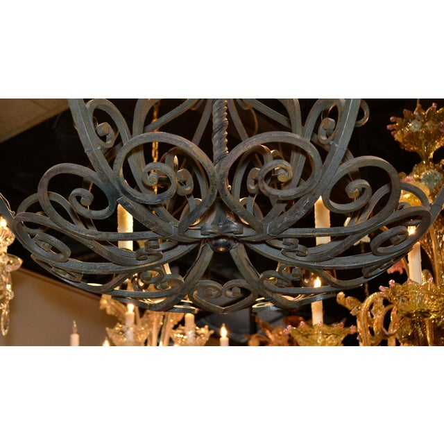 Charming antique French patinated iron 6-arm chandelier.