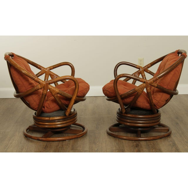 Mid Century Pair Rattan Swivel Rocking Lounge Chairs For Sale In Philadelphia - Image 6 of 13