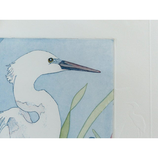 """A delicately designed Intaglio limited print titled """"The Rookery"""" by Georgia artist Judith Hall. White cranes are shown in..."""