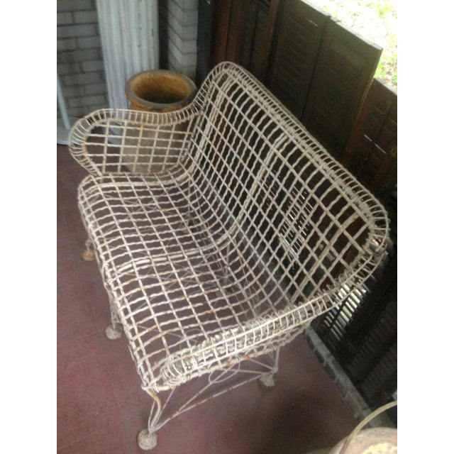 Rare French 1870s Victorian Iron Wire Patio Settee. This item is different than others similar in that the wires are...