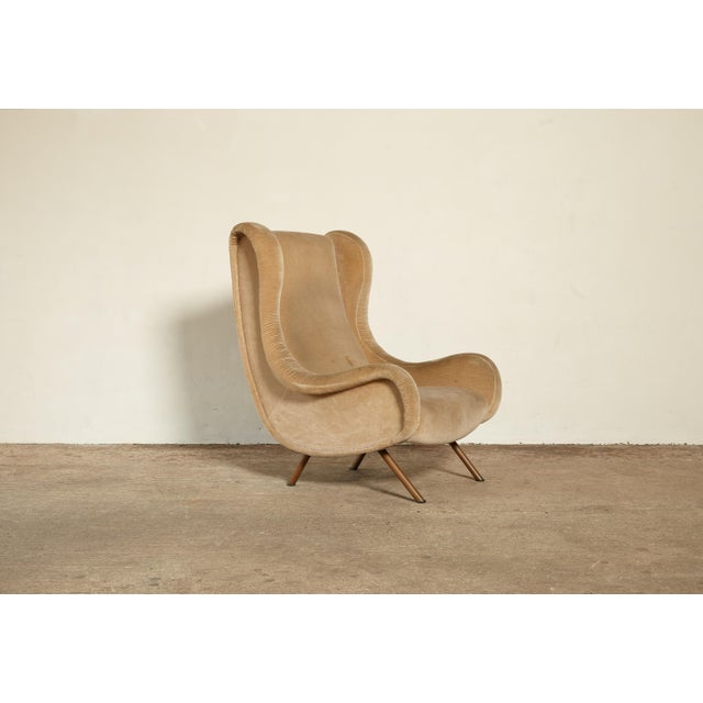 A stunning authentic Marco Zanuso senior chair, Arflex, France/Italy, 1960s. The fabric has some stains and so requires...