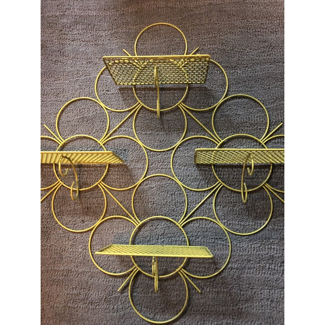 Mid century modern mesh wire shelf. Great Wall accent in yellow. Can use outside or inside for nick knacks or plants.