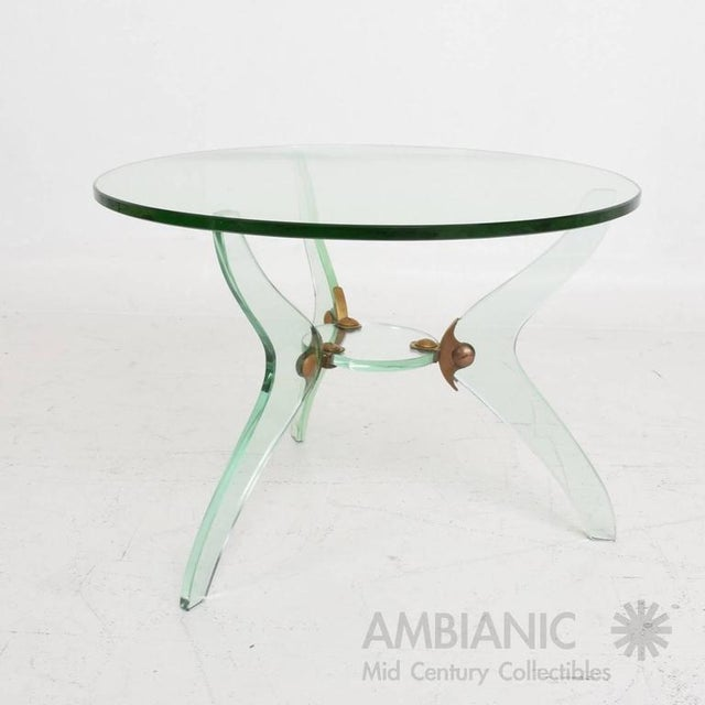 For your consideration a vintage modern round coffee table. Made in Italy, circa 1950s. Sculptural legs with round glass...