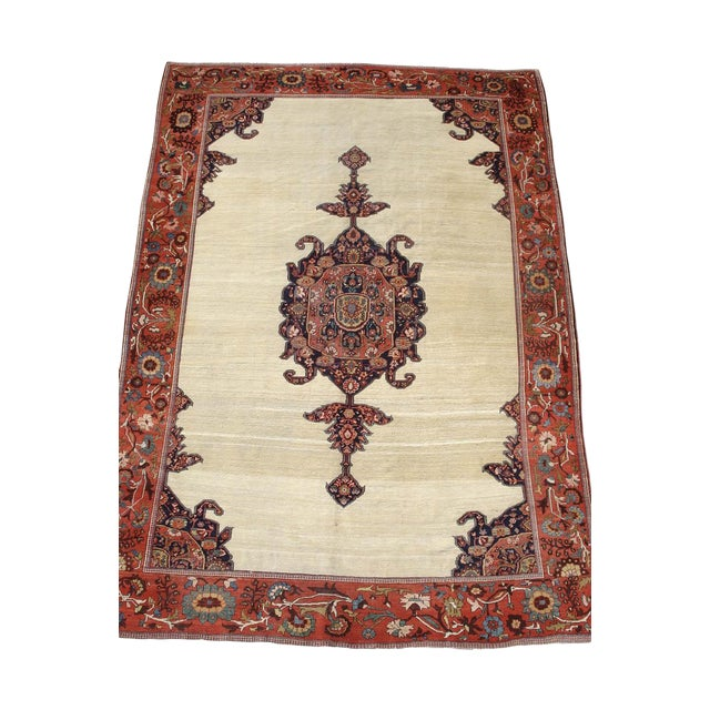 With a richly saturated central medallion floating against a clean ivory field, this fine Persian Sarouk exudes elegance....