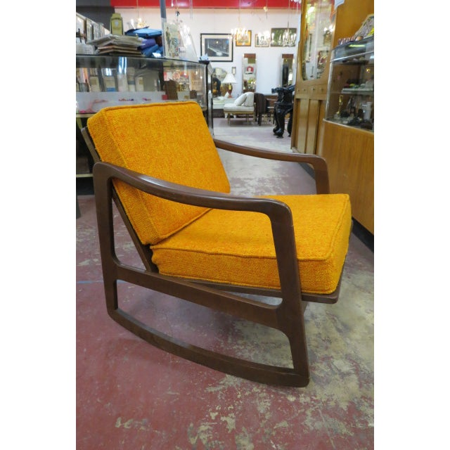 $995. Vintage Danish modern rare teak lounge chair rocker, c1960. Dark stained teak body. Curved arms. 2 cushions...
