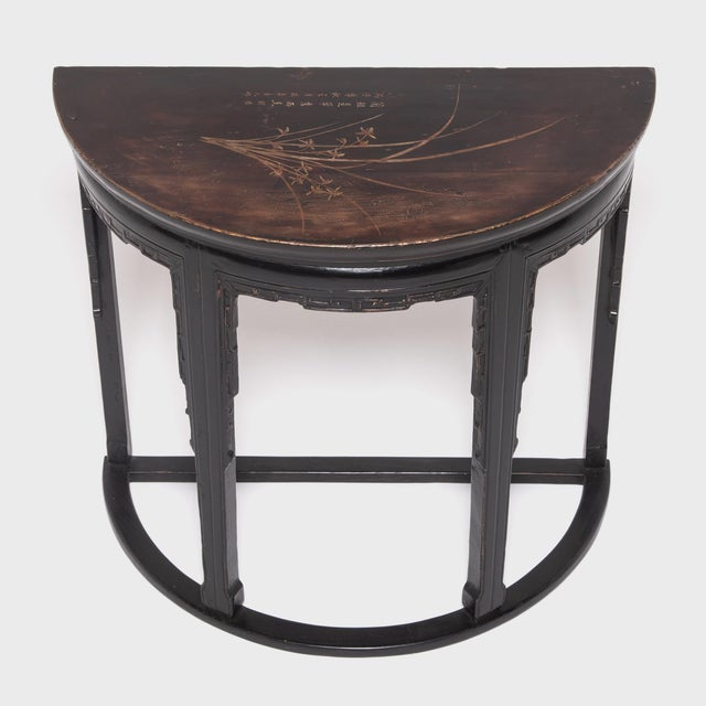 Made in 1936 at the height of the popular Art Deco style, this demi-lune table keeps with modern tastes while preserving...
