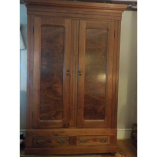 An American Late Victorian Walnut Armoire. Preview