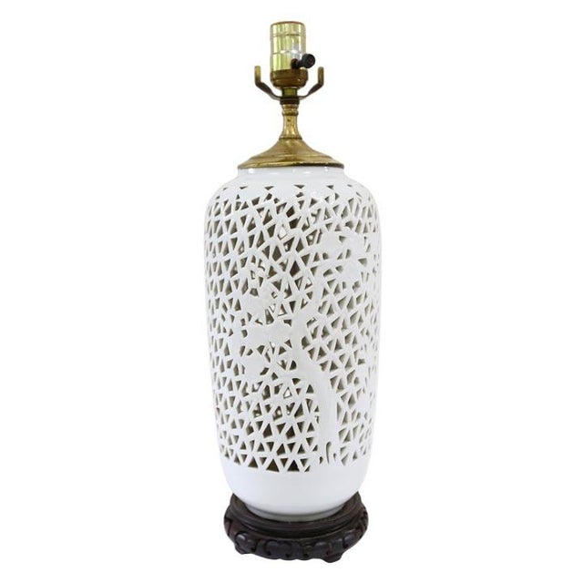 Vintage blanc de chine lamp would look stunning with a black shade. Lamp has some spots on the brass vase cover. Includes...