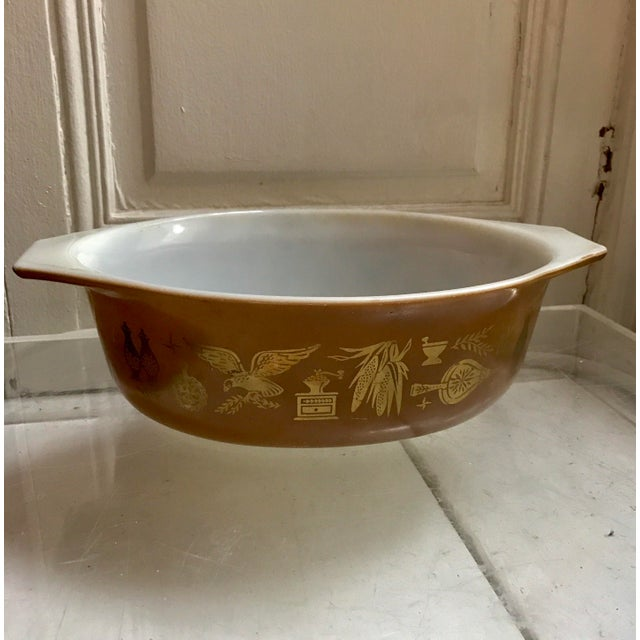 This is vintage Pyrex from the 60s or 70s in the Federal Eagle pattern in brown and gold. The pattern showcases eagles,...