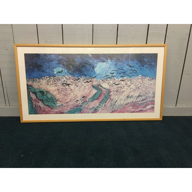 Beautiful multi-colored abstract print in an oblong natural wood frame. This piece is wired and ready to be hung in any...