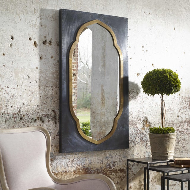 Copper clad wood frame mirror with Morrocan motif. It is oxidized to a dark charcoal color and the inside rim is antique...