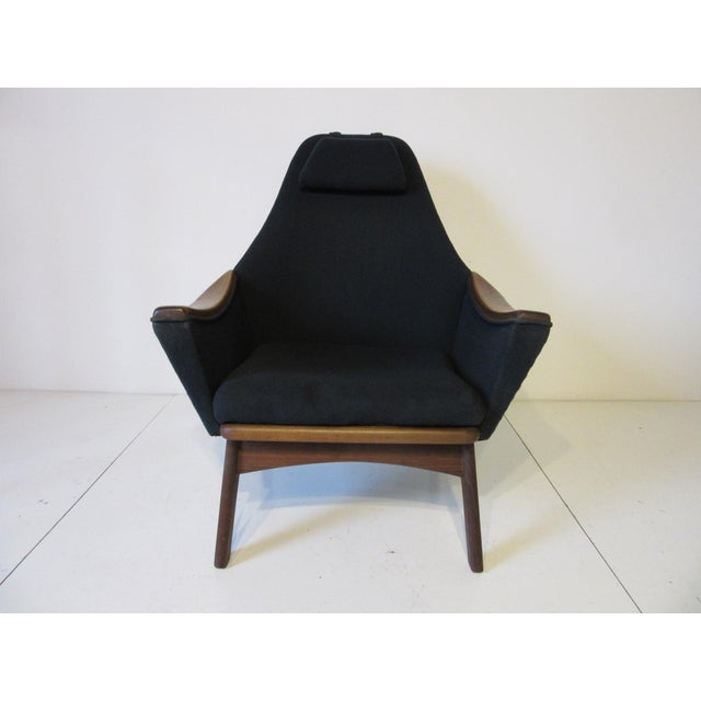 A walnut framed lounge chair with matching arms, back pillow and adjustable head pillow, in the original fabric from the...