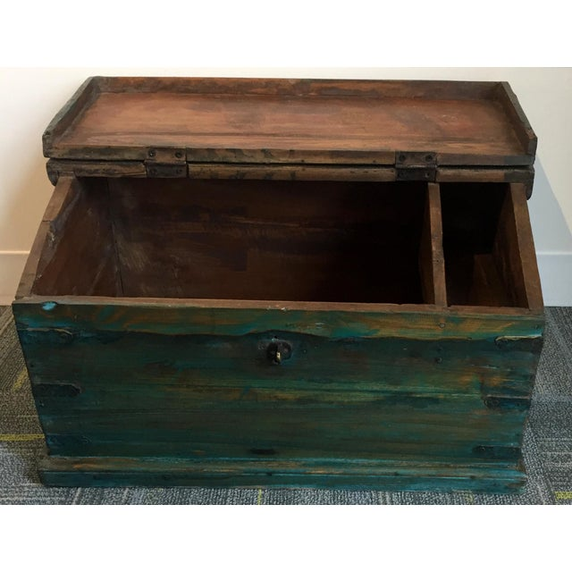 This antique children's school desk box has spacious storage inside for schoolbooks and a smaller shallow compartment for...