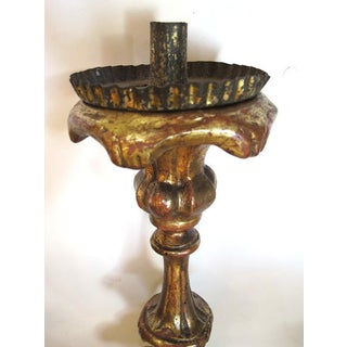 A Boldly-Scaled Italian Baroque Carved Giltwood Candlestick Preview
