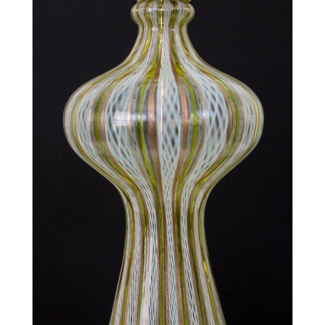 Offered for consideration is a charming vintage Murano glass lamp featuring a latticino technique in caned bands of...