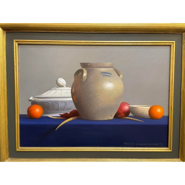Still life oil on canvas depicting fruit, a Bennington judge and iron stone pottery. Robert Douglas Hunter was a Boston...
