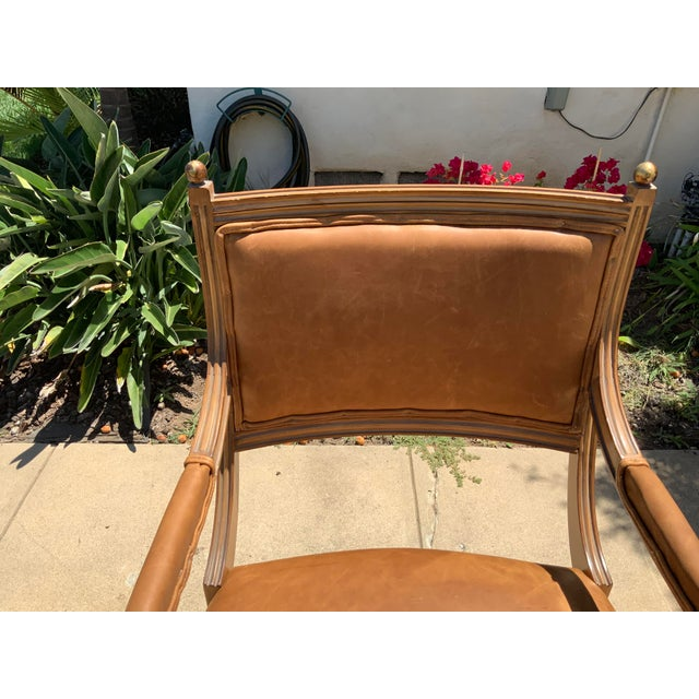 This chair has a French toast finish. The chair is in excellent condition. The chair as reupholstered for the listing in a...