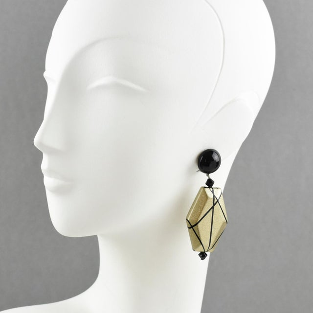 Very chic Angela Caputi, made in Italy resin clip on earrings. Dangling shape with black color contrasted with pale gold...
