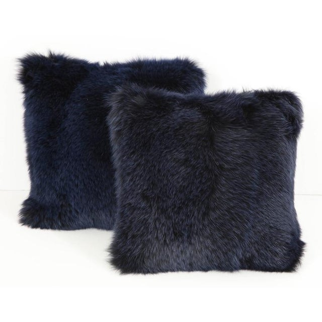 A pair of glamorous and luxurious fox fur pillows in a dramatic midnight blue, backed in navy cashmere. The perfect...