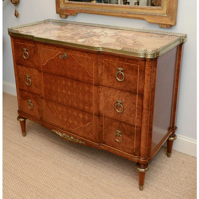 Secretaire, having notched marble top with 3/4 pierced bronze gallery, the top drawer opens to a writing surface and...