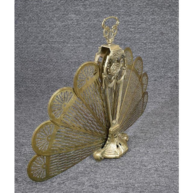 This Beautiful Fireplace Screen is made of Solid Brass. It has a Victorian lady on the front and back. The pierced fan...