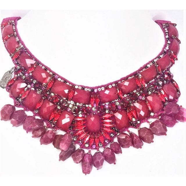 Handmade with a center of long, narrow red marquis rhinestones, rose color, flat back, rectangular, faceted stones & rose...