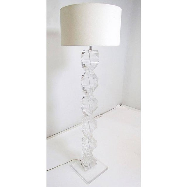 """This is a stunning and beautiful lucite floor lamp with stacked """"spiral"""" lucite blocks creating a beautiful 3D look and..."""