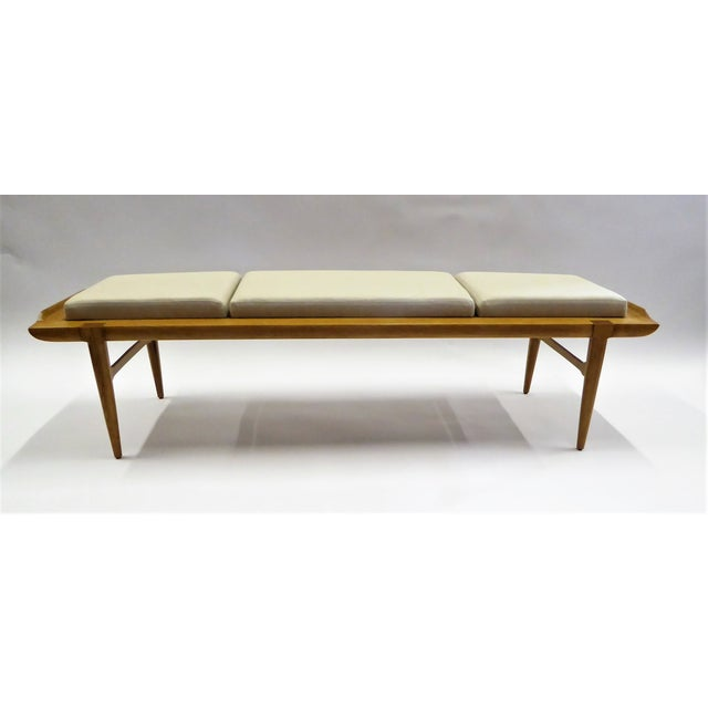 """1950s Tomlinson """"Sophisticates"""" line modern 5 ft. long bench in blond walnut with attached linen upholstered cushions...."""
