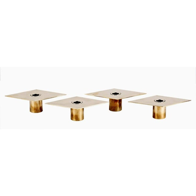 Set of four rhomb-shaped brass Candleholders designed by Sigurd Persson (1914-2003) Sweden. Solid brass cylindrical base...