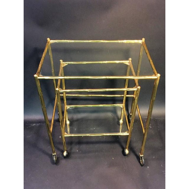 French EXCEPTIONAL PAIR OF BAQUES BRASS BAMBOO NESTING TABLES ON WHEELS For Sale - Image 3 of 10