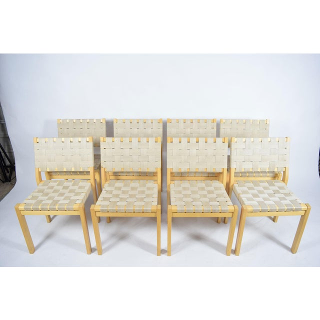 A set of eight Alvar Aalto for Artek 615 chairs with birch frames and flax webbing. Priced at $525 each.