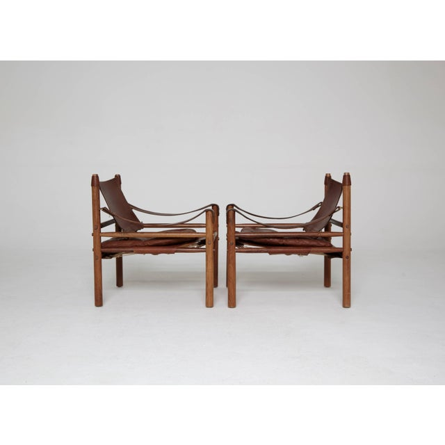 Arne Norell Arne Norell Rosewood and Brown Leather Safari Sirocco Chairs, Sweden, 1960s For Sale - Image 4 of 9