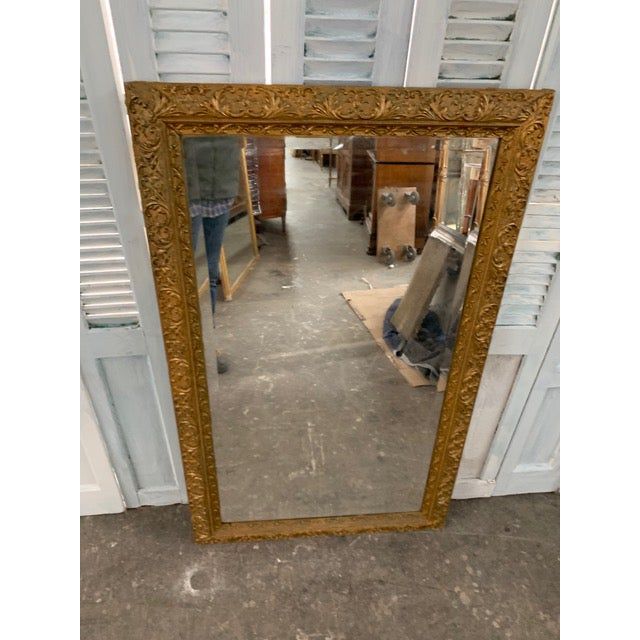 Beautiful Louis XVI giltwood mirror with original mercury glass. Circa 1750s. Ornately carved with foliate and floral...
