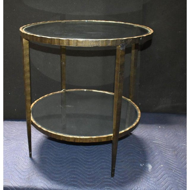 Two tiers glass and mirror iron round side table with bronze patina. Made in the 1960s.