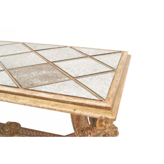 French 1940s oak and gilt finish rectangular coffee table with scroll carved legs connected with a stretcher and a...