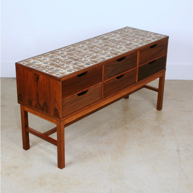 Set of drawers in rosewood with tiles from Royal Copenhagen. Designed by Severin Hansen and manufactured by Haslev...