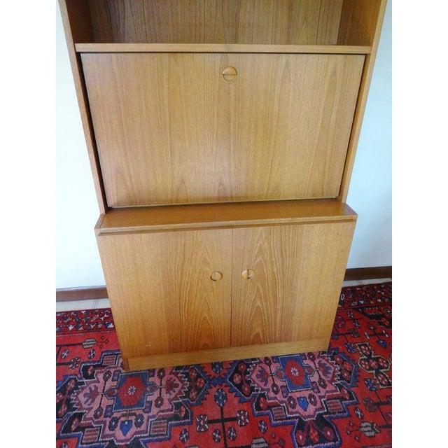 Beautiful vintage secretary desk, by Gregory Van Pelt. It features a lovely teak finish with recessed teak pulls. Part...