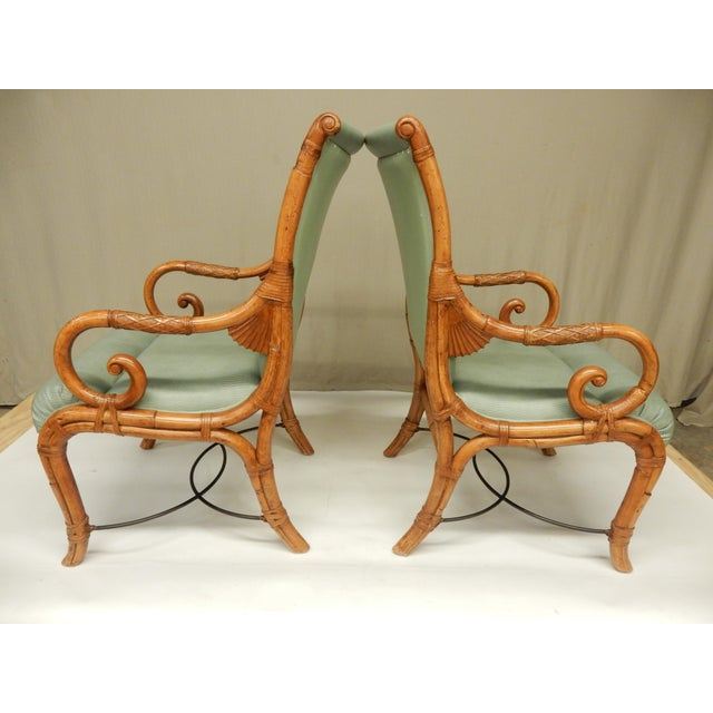 Pair of elegant bamboo arm chairs by Maison Jansen. The quality of construction is shown in the intricate details that...