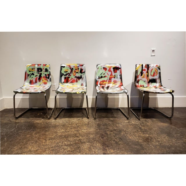 Set of 4 vintage acrylic Carl Ojestram for Ikea dining chairs. Painted in rich tapestry of overlapping spray paint...